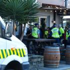 An ambulance and police at the scene of an assault in Brazz bar late this morning. Photo: Guy...