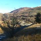 Contractors work on power lines above the Shotover Bridge, near Queenstown, yesterday. Two lines...