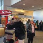 Love ones reunite at Queenstown Airport today. Photo: Matthew Mckew