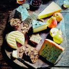 Place cheeses on a serving board with a separate knife for each, and a varied selection of...