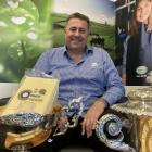 Fonterra Stirling dairy processing plant manager Morgan Watt and the two awards the cheese...