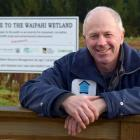 Waipahi Wetland project manager Shane Bocock rests on a gate at the wetland in South Otago last...