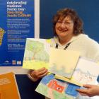 Dunedin Public Library events co-ordinator Kay Mercer shows some of the colourful entries she has...