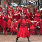 Dunedin dancer Hannah Rouse leads a red-clad local contingent during last year's Most Wuthering...