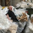 Otago Pellet Fires owner Martin Wilkes takes a break on plastic bags waiting to be recycled....