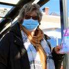 Anne Marie Parsons, of Kaikorai Valley, shows face masks she gives out for free to bus users....
