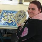 Kelly New, of South Dunedin, shows a mosaic she created from broken teapots and saucers at...