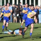 Taieri winger Marc Rooney makes a break during the Dunedin premier club rugby semifinal against...