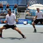 Michael Venus and Marcus Daniell of New Zealand celebrate after match point during their Men's...