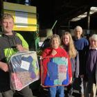 Operation CoverUP volunteers visit Taieri Wool & Skins near Mosgiel on Monday to bale up a...