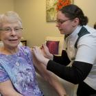 Summerset at Bishopscourt resident Glenys Webber receives her Covid-19 vaccination from Roslyn...