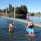 Emerging from the 9degC water at the Lake Hawea boat ramp jetty after their polar plunge...