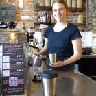 Urban Grind eatery and bar manager Jennifer Rynearson makes a coffee in a reusable and recyclable...