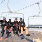 The first skiers and snowboarders to ride on the Willows quad chair were (from left) Timon Tasker...