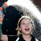 Taking her first drink of town-supply water in six months is Waikouaiti School pupil Charlee...