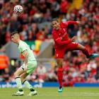 Liverpool defender Virgil van Dijk (right) competes for the ball with Athletic Bilbao defender...