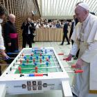 Pope Francis plays table football during his weekly general audience in the Vatican. PHOTOS:...