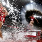 Moroccan athletes Soufiane Elbakkali and Mohamed Tindouft compete during the final of the men's...