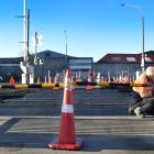 Safety gates are being installed at the St Andrew St rail crossing in Dunedin as part of an...