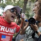A Trump supporter and protestor engage in California. Photo: Getty Images