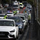 Police conduct roadside checks with drivers heading towards the Anzac Bridge in Sydney over the...