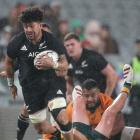 Ardie Savea avoids a tackle from Tate McDermott during the second test at Auckland's Eden Park....