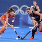 Eva Roma Maria de Goede of Netherlands and Katie Doar of New Zealand battle for the ball during...
