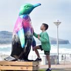 Checking out a 2m-tall penguin sculpture that made an appearance at the St Clair esplanade on...