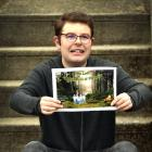 Showing a poster for the postponed Kaikorai Valley College special needs production is actor Cody...