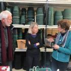 Dunedin Botanic Garden senior staff member Alice Lloyd-Fitt (centre) gives tips on propagation to...