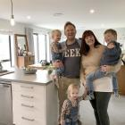 Enjoying their new home in Wanaka are Ivy (2), Kenny, Maisie (2), Carrie and Rory (4) Vaugh....