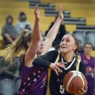 Ajax guard Nicole Ruske tries to get around South Pac Magic defender Millie Simpson during the...