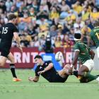 Will Jordan of the All Blacks is tackled by Siya Kolisi of the Springboks during the Rugby...