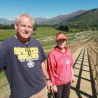 Derek and Anna Brown pictured on the controversial boardwalk outside their Arrowtown house in...