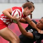 Alina Arterchuk of the Russian Olympic Committee in action against New Zealand's Alena Saili...