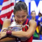 Emma Raducanu celebrates with the championship trophy after winning the US Open today. Photo::...
