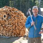 Queenstown builder Jeff Hylton pictured with his firewood owl sculpture. PHOTO: CASS MARRETT