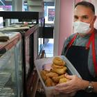 Lawrence's La Boulangerie barista Deon Vosloo restocks the cabinets at the very popular bakery....