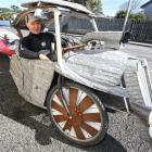 Kaka Point stand›up paddleboarder and corrugated iron sculptor Tony Somerville with the home...