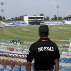 A member of the Police Elite Force stands guard at the Rawalpindi Cricket Stadium, after the New...