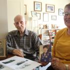 Les King, of Winton, and his daughter Judith Smart, of Ashburton, look over family photos and Mr...
