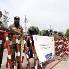 Pakistan security officials at a road block near the stadium in Rawalpindi. Photo: Getty Images