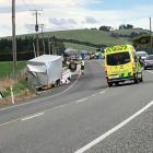Emergency services at the scene this afternoon. Photo: Barry Stewart