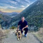 National Party Southland MP Joseph Mooney out for a walk with a dog. PHOTOS: FACEBOOK
