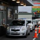 Burger lovers queue at McDonald's in Linwood. Photo: George Heard