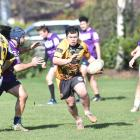 Aiden Muraahi scrambles to make ground for the Kia Toa Tigers during their game against the South...