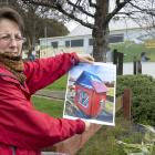 Lilliput Library founder Ruth Arnison holds a photograph of the Rotary Park Kindergarten Lilliput...