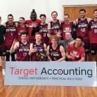 Mid City Magic celebrate after winning its fifth consecutive Dunedin men's club basketball title...