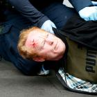 Victoria Police arrest a man is arrested in Elizabeth St  as protests continued in Melbourne...