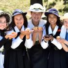 Tucking in to cupcakes while dressed in old school uniforms and late-1800s fashion, to celebrate...